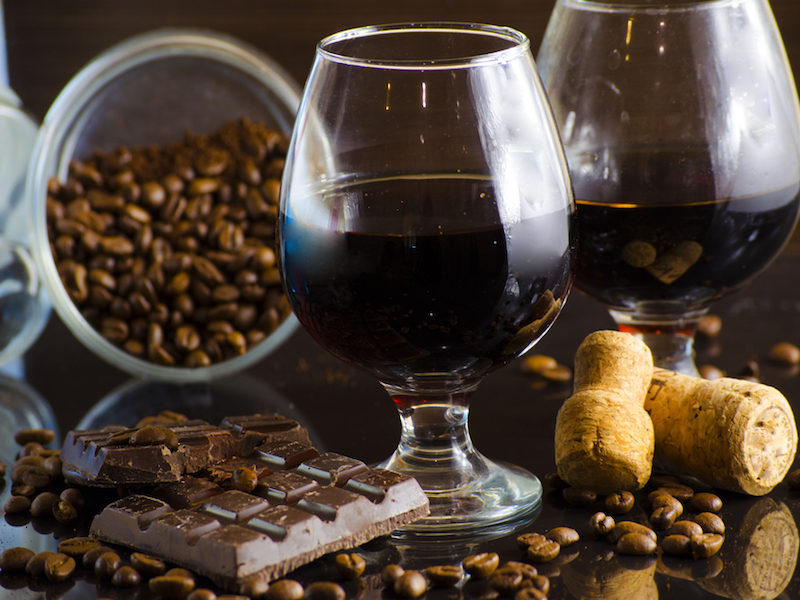 rum and chocolate in a glass on a dark background